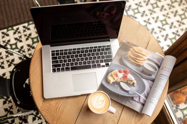 Laptop with a cup of coffee. work from home. work from a coffee shop. time  for yourself | Premium Photo